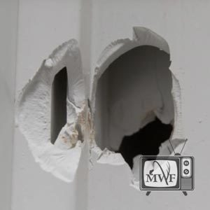 bullet hole in a wall