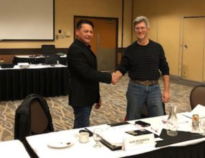 sam murdock from lake winnipeg fishery co management board shaking hands with previous managing director brian kotak