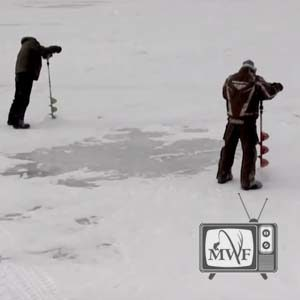 two men standing on ice drilling holes using augers