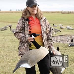 woman holding a goose decoy