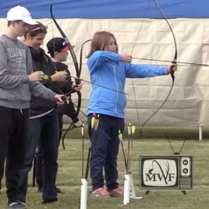 girl shooting a bow at prepare for provincial hunting day
