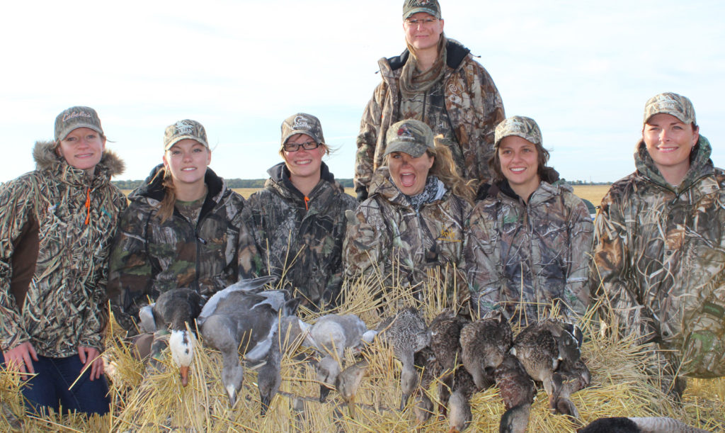 group picture of successful hunters from the ladies mentored hunt